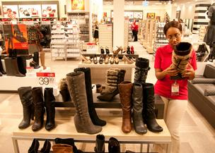 Employee Mary Henley takes a moment for some shoe shopping.