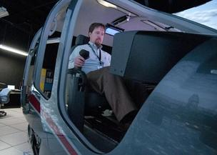 Staff Writer Matt Joyce takes control of Bell Helicopter simulator.