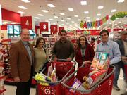 Employees at UCR in Dallas and other Texas cities participated this week in the company's Adopt-A-Family program. In Dallas, the real estate services company's workers adopted five families from The Family Place and five from Genesis Women's Shelter. Ten teams from UCR spent Tuesday shopping for the families, assembling and wrapping gifts and then delivering the gifts to the charities.