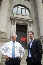 Kirby White and Mark Lea stand outside the old Municipal Building in downtown Dallas.