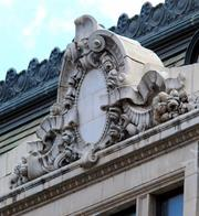 A detail above the side entrance to the old Municipal Building.