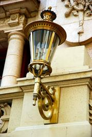 A light fixture at the Adolphus gives a classic look to the exterior.
