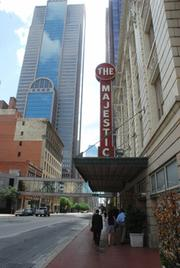 The Urban Armadillos walk under the awning of the Majestic Theatre during their stroll in downtown Dallas.