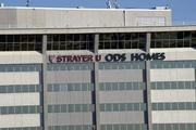 Strayer University signage is replacing Ashton Woods Homes atop Gateway Tower.