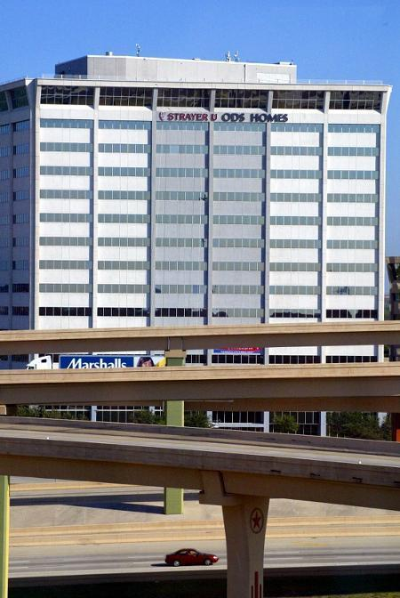 Ashton Woods Homes signage is being replaced on the Gateway Tower on LBJ Freeway in Dallas.