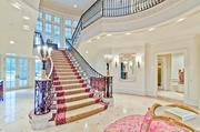 The grand staircase at Champ d'Or in Hickory Creek.
