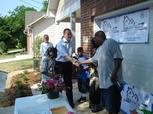 The Dallas Bar Association dedicated its 21st house for Habitat for Humanity. The association is the longest-running whole-house sponsor and builds a Habitat home each spring. Above, Paul K. Stafford, association president, hands over the keys to the Gree