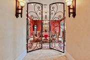 Wrought-iron doors lead to a dining area in Tom Leppert's Dallas home.