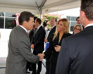 Gov. Rick Perry shakes hands with Irving Mayor Beth Van Duyne at the Connextions announcement Tuesday.