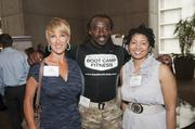 From left, Lin and Jay Johnson of Jay Johnson's Boot Camp Fitness with Sophia Gibson Williams, DFW Dance Fitness at the DBJ's Healthiest Employers Health Fair.