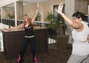 DFW Dance Fitness Zumba Instructors Carla Riffel and Sophia Gibson Williams at the DBJ Healthiest Employers Health Fair.