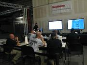 Officers take part in a debriefing following the virtual training session at Raytheon.