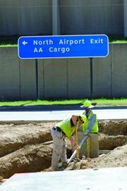 Workers at the site of DART expansion at Dallas/Fort Worth International Airport.
