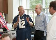Scott Boer talks football with Roger Staubach during Jones Lang LaSalle's annual tailgate party.