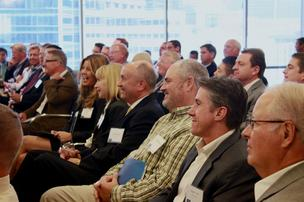 KC Conway speaks to a crowd at Colliers International in Dallas.