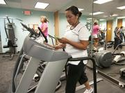 Michaels administrative assistant Alicia Martinez uses the on-site gym during work hours.