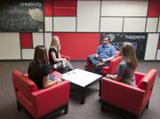 Michaels headquarters provides break-out meeting areas. From left to right, Loren Rutledge, Amanda Gray, James Flair and Jill Marlowe have a human resources meeting.