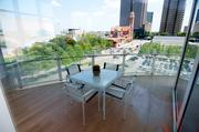 A patio at a condo in the Museum Tower looks out over downtown Dallas.