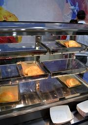 Beef and chicken empanadas are two of the new food items in the offing at 7-Eleven stores.