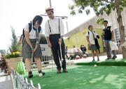 Pegasus school student Jasmine Andablo gets a quick croquet lesson from 1900 Elm's Joe Andrade
