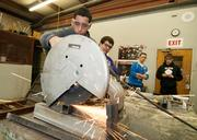 Isaac Correa with a cutting tool in Ag Mechanics class at Palmer High School.
