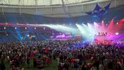 Multicolored lights wash the crowd at the GOP welcome party Sunday in St. Petersburg's Tropicana Field.