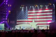 A giant American flag serves as a backdrop while Rodney Atkins performs.