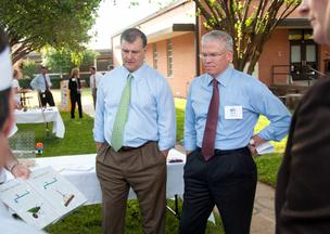 Dallas Mayor Mike Rawlings and Texas Instruments CEO Rich Templeton observe fifth-graders at work at Gabe Allen Charter School.