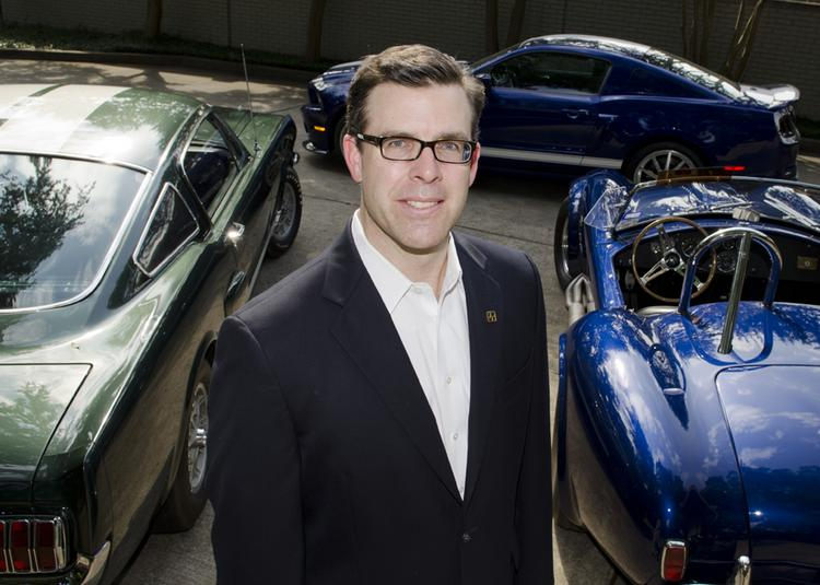 Aaron Shelby, vice president of TexasLegacy Bank, with some of the cars his father Patrick Shelby has at his home. Pictured are a 1966 Shelby GT350 Mustang,  a 2013 Shelby Super Snake Mustang and a Shelby 427 Cobra built as a continuation Cobra in 1994 using 1966 parts.