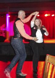 Chip Pemberton and Peggy Worley get footloose during a Skintastic birthday party.