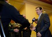 Sen. Ted Cruz answers reporters' questions after the Richardson chamber event.