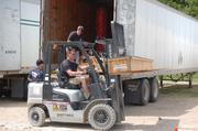 Workers unloading crates of Dale Chihuly artwork at the Dallas Arboretum Monday.