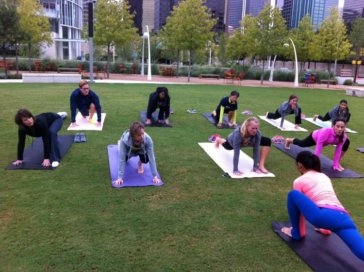 Yoga enthusiasts (if that's what you call them) do poses and stuff in Klyde Warren Park.
