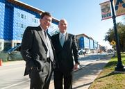 John Hall, left of UT Arlington and Kirk Williams of Cypress Equities stand in the College Park development at the University of Texas at Arlilngton.