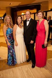 Kathy Hansen, Lorraine Teel, Jim Berry and Sue Ansel at the Real Estate Council's FightNight.