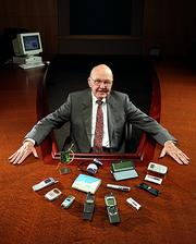 The late Jack Kilby shows off some of the electronic items made possible by the integrated circuit.