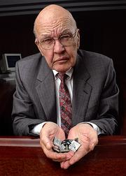 The late Jack Kilby shows off his world-changing invention - the modern integrated circuit.