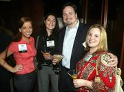 Sarah Duke and Candace Carlisle of the DBJ stand with Kenneth Kracmer and Kerri Fulks of HCK2 Partners.