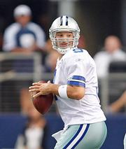 Roger Staubach says he's a fan of current Cowboys quarterback Tony Romo.