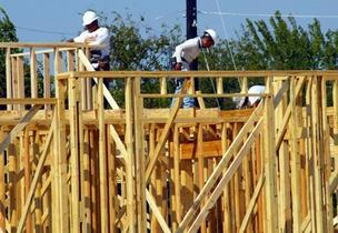 Construction workers build a commercial property in Trophy Club.