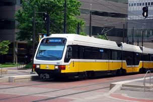 A Dallas Area Rapid Transit light rail train moves through downtown Dallas.
