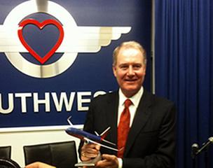 Southwest Airlines CEO Gary Kelly shows off a model of the Boeing 737 MAX aircraft that the airline has ordered.