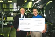 The Ford Motor Co. assisted the Visiting Nurse Association's Meals on Wheels program. The company gave the program a check for $2,500. From left: Bill Flynn, general manager of Ford Lincoln Marketing, Sales, and Service; and Robert Carpenter, president and CEO of the Visiting Nurse Association.