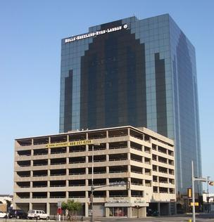 A law firm has leased the former Blue Cross Blue office building in downtown Dallas.