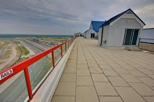 Two penthouses overlooking Texas Motor Speedway sold at auction.