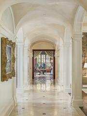 The marble hallway at 9806 Inwood Road opens up into various rooms in the house.