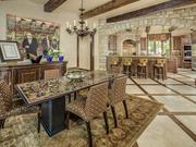 The kitchen at 9806 Inwood Road opens up into a dining area.