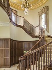 The foyer connects to a grand staircase at 9806 Inwood Road.