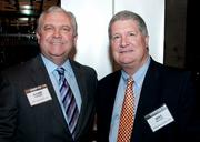 Randy Wight of UHY Advisors TX LLC and Mike McCall of the Dallas Stars.