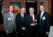 Bob Knight of Lane Gorman Trubitt LLC, Ken Sibley of Sibley & Co., Jack Savage Jr., and Robert Dorazil, of UCD Development, celebrate the release of the Dallas Business Journal's Book of Lists.